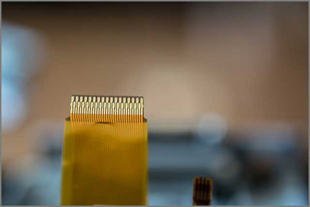 An image of flat and ribbon cable on blurred background