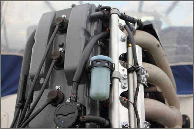 Close up the rear side of boat transom four-stroke outboard motor