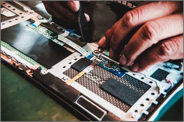 An image of a technician plugging ribbon cable
