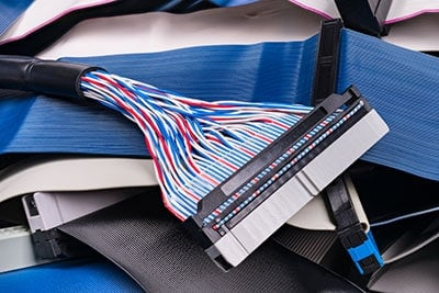 Colored multi wire parallel connector detail on ribbon cables pile