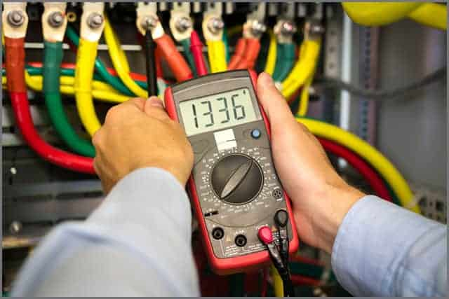 Electrical tester in the hands of the engineer