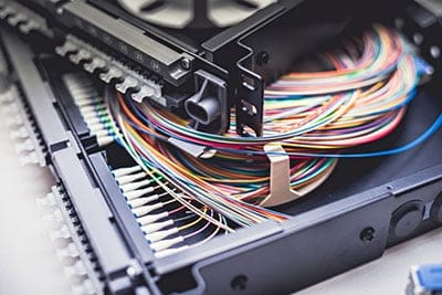 Cables on top of patch distribution panel shelf