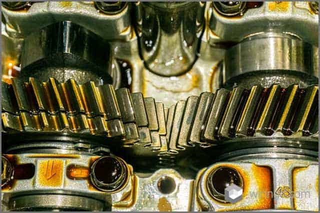 Gears in a car engine with lubricant oil on repairing