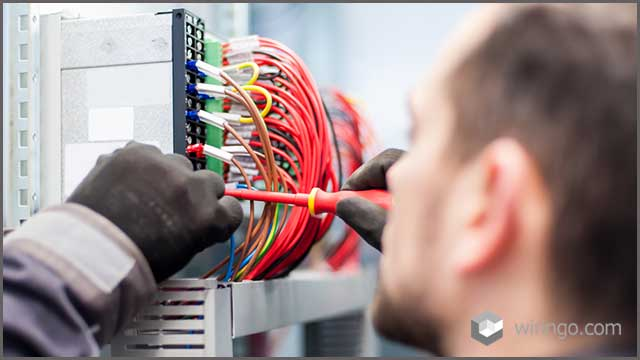 Electrician engineer works with electric cable wires