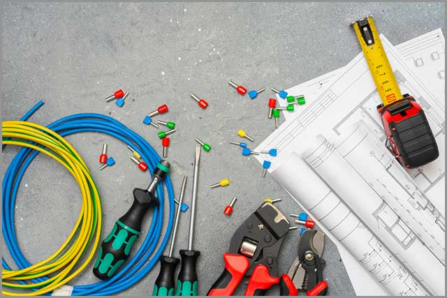 Tools and tips of different sizes and colors for crimping stranded electrical wires