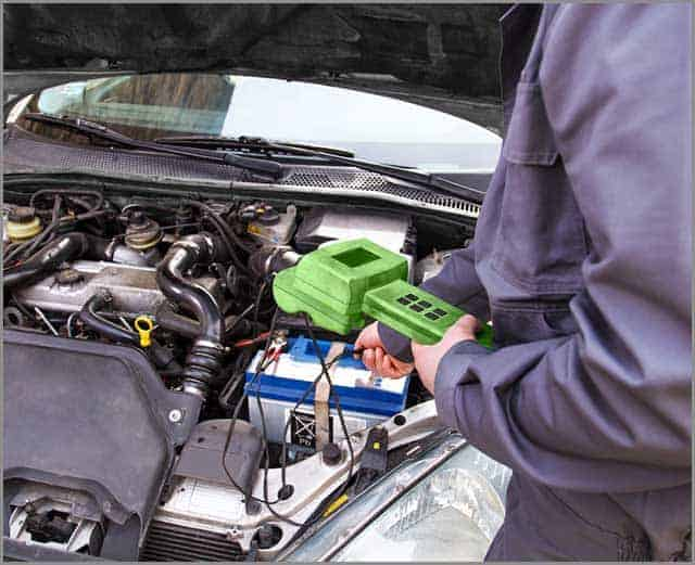 Automobile Wire Harness--Mechanic Checking the Electrical System in a Car