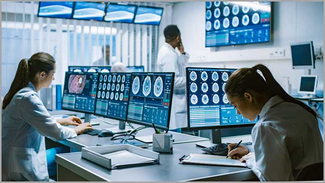 Monitor systems showing CT and MRI scans