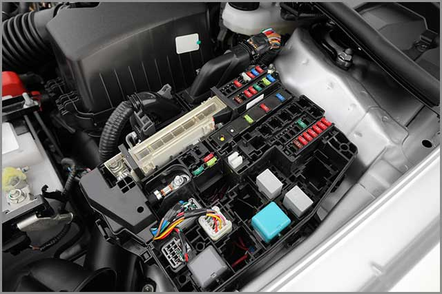 Automobile Wire Harness--Detail of a Car Engine Bay with Fuses