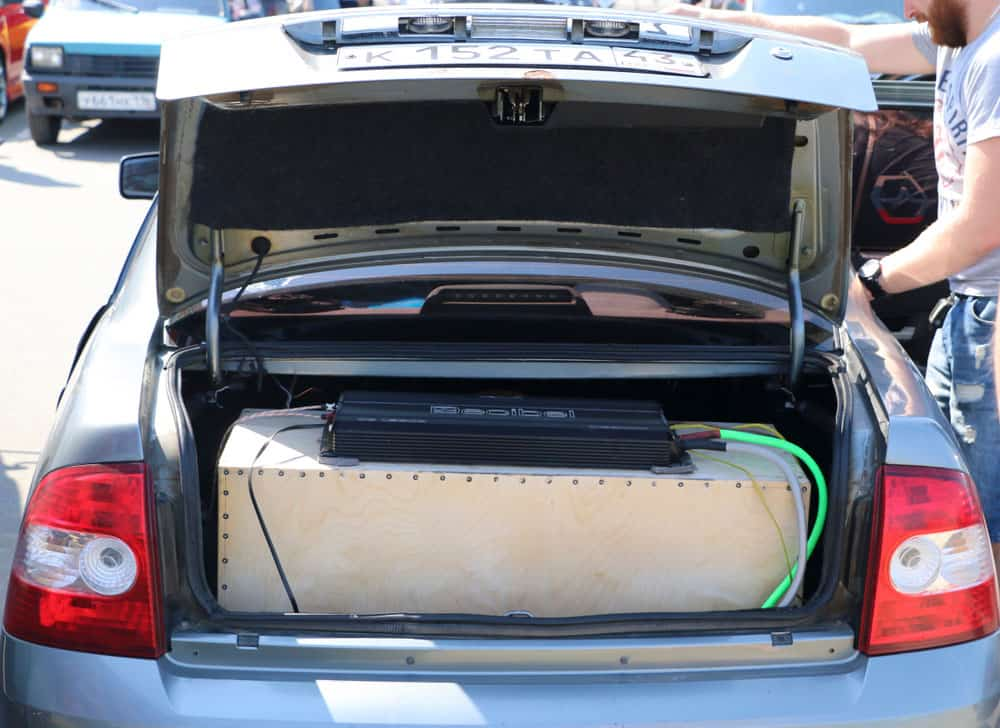 Car with an aftermarket amplifier in the trunk.