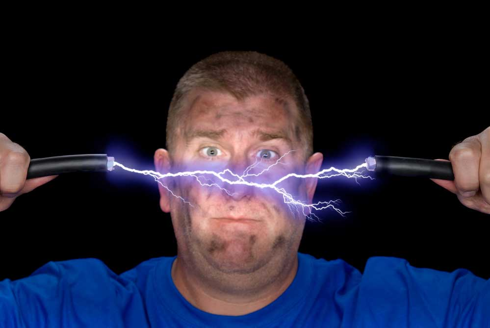 Man holding arcing electrical wires.