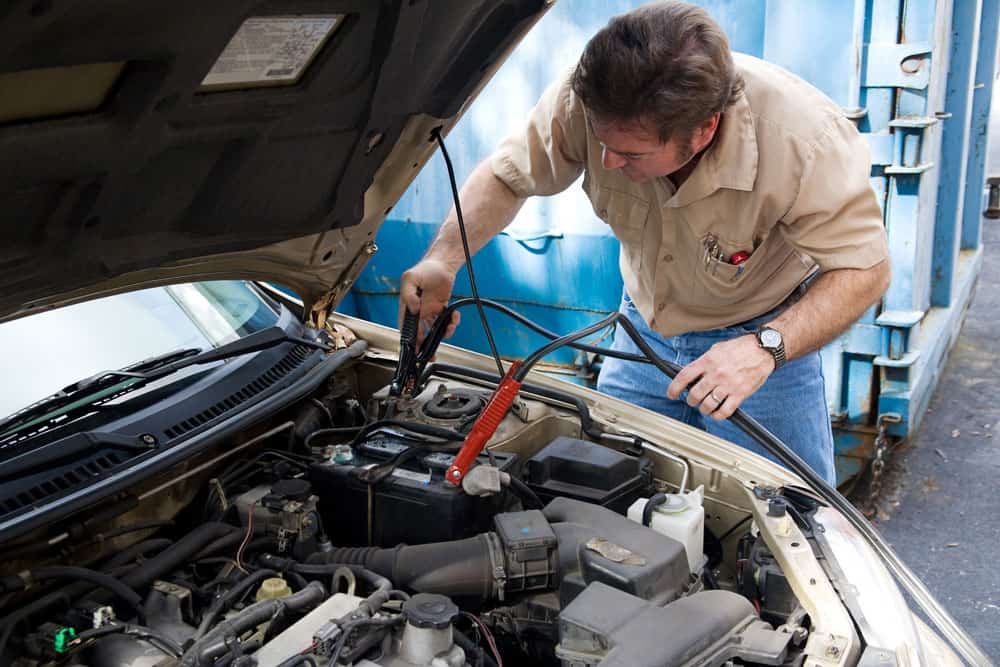 Serviceman working with auto cables