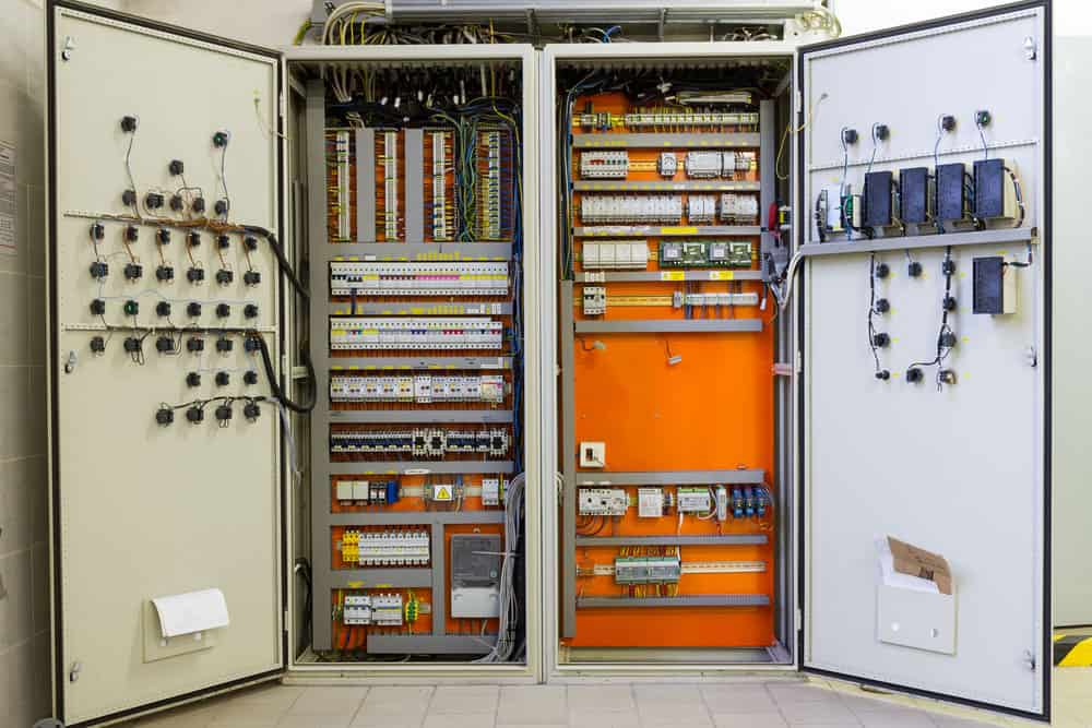 electricity distribution box with circuit breakers and wires