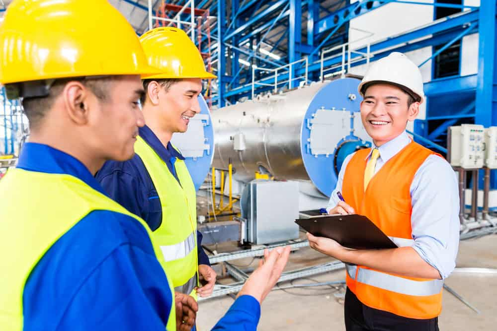 Factory workers with an engineer